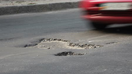 decadência : Potholes on the old highway in the city Vídeos