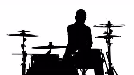 джаз : Silhouette of drummer playing drums