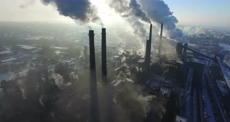 környezeti : Flying over smoke steel plant pipes. Environmental pollution. Aerial survey