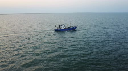 fishermen : Fishing boat in the Azov Sea at sunset. aerial survey