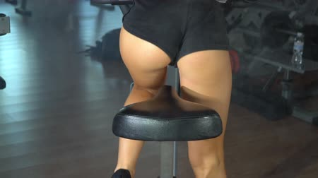 bicycle : Beautiful girl is training on exercise bike in the gym. Slow motion