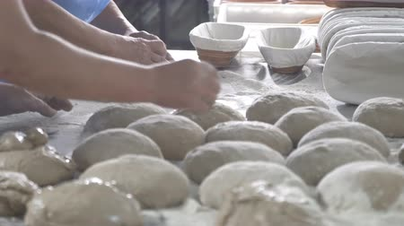 gumka : Baker packs dough for bread
