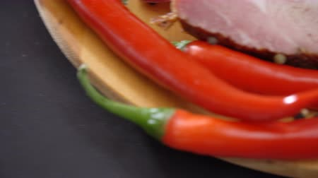 peperoni : Chilli pepper on the cutting board Stock Footage