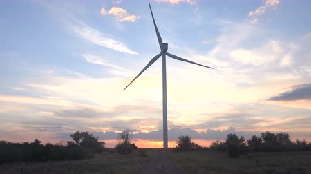 clean electricity production : Wind power plant at sunset