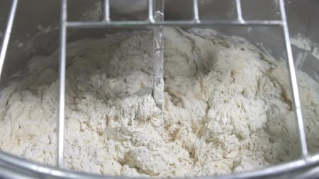 bread pan : Knead the dough in the vat. slow motion Stock Footage