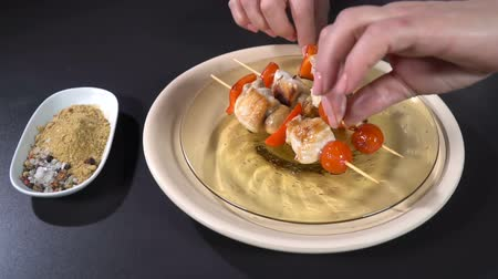 appetizing shish kebab : Put chicken skewers on a plate. Slow motion