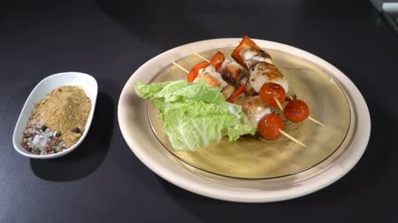 appetizing shish kebab : Server plate with chicken kebab. Slow motion
