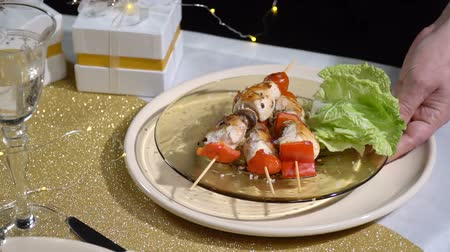 pronto a comer : Take off the table with a plate of kebabs. SlowMo Stock Footage