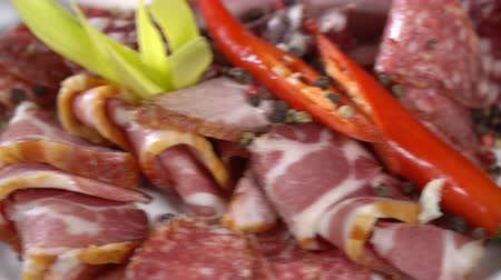 fumado : Smoked cold cuts on a plate