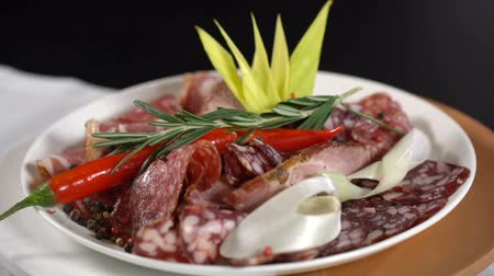 salame : Dish with meat sprinkled with rosemary. slow motion