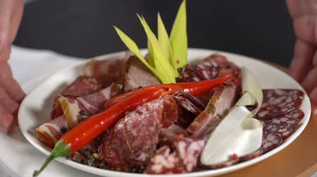 red chili pepper : Take a dish with smoked meat. slow motion