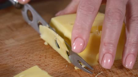 пармезан : Cheese with holes cut with a knife. slow motion Стоковые видеозаписи