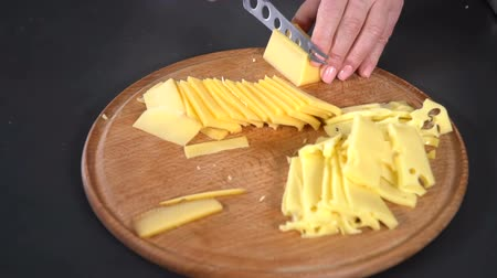 pieces of cheese : Hard cheese cut with a knife. slow motion