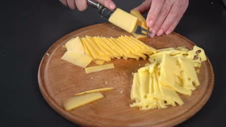 parmigiano : Hard cheese cut with a knife. slow motion