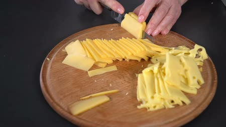 cheese piece : Hard cheese cut with a knife. slow motion