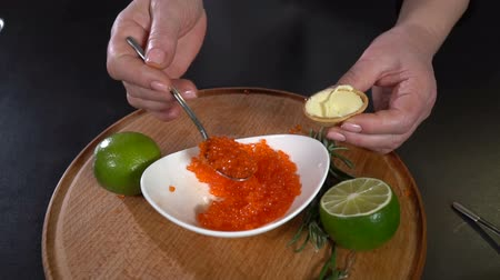 tartlet : Red caviar is put into the waffle tartlet. slow motion Stock Footage