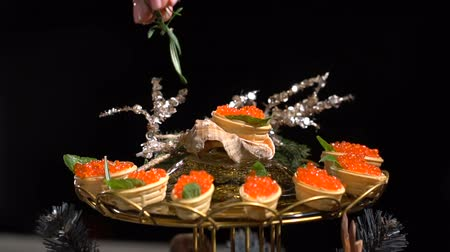 tartlet : Tartlets with red caviar. slow motion