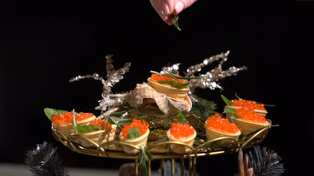 jikry : Tartlets with red caviar. slow motion