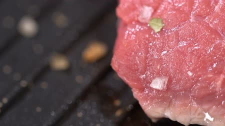 lombo de vaca : Raw steak fried in a pan. slow motion
