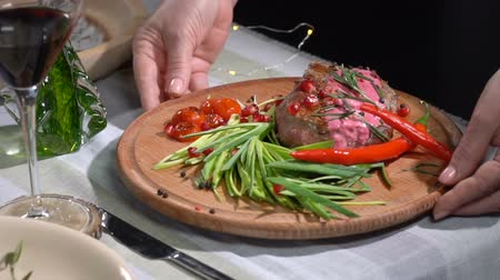 hátszín : Ready steak is removed from the table. slow motion
