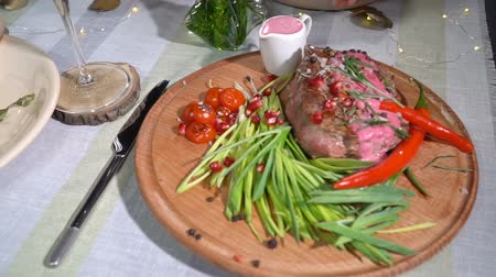 pırasa : Ready steak on the holiday table. slow motion Stok Video