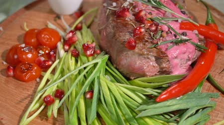 dana eti : Ready steak on the holiday table. slow motion Stok Video
