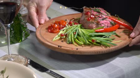barbecue set : Ready steak served on the table. slow motion