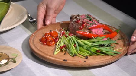 dana eti : Ready steak served on the table. slow motion