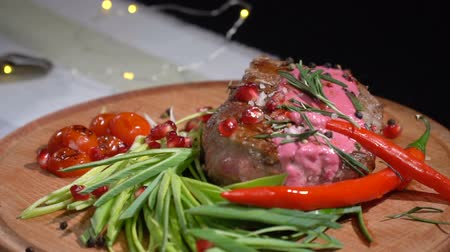 столовые приборы : Ready steak sprinkled with spices. slow motion