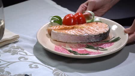 capsicum : Dish with salmon put on the table. Slow motion