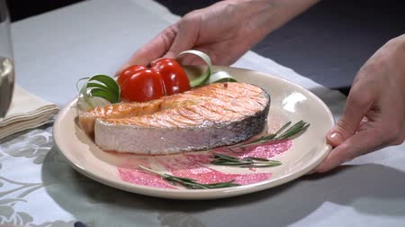 chives : Dish with salmon put on the table. Slow motion