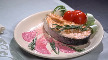 slate : Salmon steak sprinkled with rosemary. Slow motion Stock Footage
