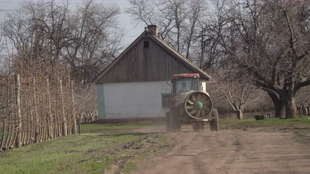 blight : Tractor with a sprayer in the garden
