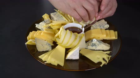 rustik : Spread pear slices on a plate of cheese