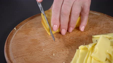 pieces of cheese : Cook cuts hard cheese Stock Footage