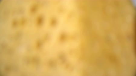 camembert : Hard cheese with holes on the cutting board Stock Footage