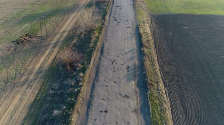 deteriorated : Pothole road. Aerial survey Stock Footage