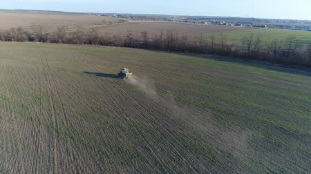 atomizer : Tractor makes fertilizer. Aerial survey Stock Footage