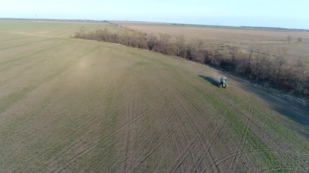 field survey : Tractor makes fertilizer. Aerial survey Stock Footage