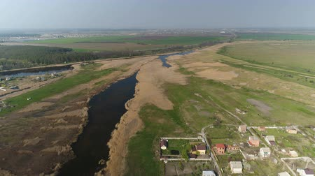 field survey : Flying over the river with reeds in spring. Aerial survey Stock Footage