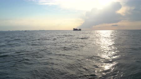 freighter : Cargo ship in the Black Sea at sunset. Video filming from the yacht Stock Footage