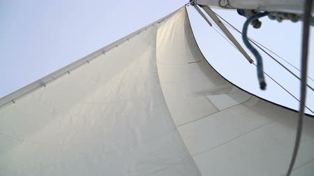 yat yarışı : Mast with a white sail on a yacht in the Black Sea