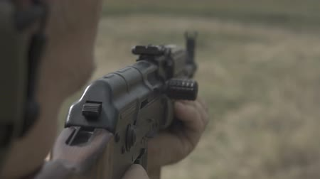 trigger : Shooting the rifle at training ground. Slow motion Stock Footage