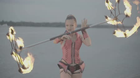 só : Girl with a torch fire show on the river bank at sunset. slow motion S-Log3, S-Gamut3, Cine