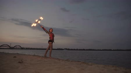 feiticeiro : Girl with fire by the river at sunset