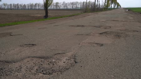 old pit : Old asphalt road with potholes and pits