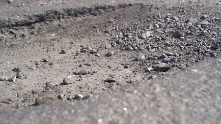 pocsolya : Old asphalt road with potholes and pits
