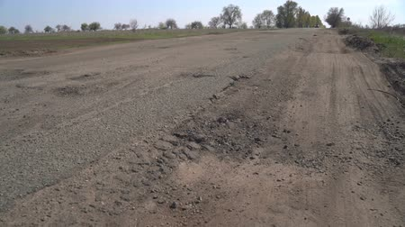 tarmac : Old asphalt road with potholes and pits