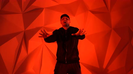 rapper : Rapper guy rap in front of the camera on a red background Stock Footage