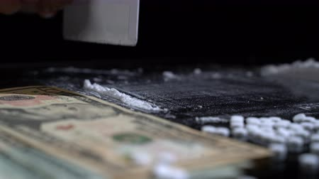 kokaina : White cocaine powder on a table with dollar bills Wideo
